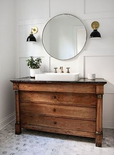 Here's my cottage bathroom inspiration. We found an old dresser that we converted to a vanity. We've put black granite countertops on it.