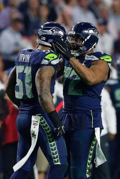 New England Patriots vs. Seattle Seahawks - Bruce Irvin #51 and Michael Bennett #72 of the Seattle Seahawks react in the second half against the New England Patriots during Super Bowl XLIX at University of Phoenix Stadium on February 1, 2015 in Glendale, Arizona. (Photo by Tom Pennington/Getty Images)