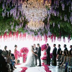 A giant installation of greenery, wisteria and chandeliers hung over the ceremony space. SLS Hotel, Beverly Hills.