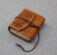 miniature journal : brown printed wraparound leather cover with leather strap. {EV Miniatures}