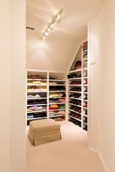 Narrow shelves make the most of this attic space and are perfect for things like sweaters which are best stored flat, not hung up.