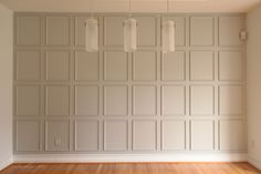 Small trim in squares add architectural interest to a focal wall. See DUI tutorial on studio36interiors.com