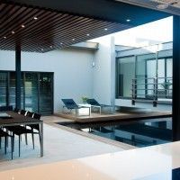 Nico van der Meulen Architects have designed the House Aboobaker in Limpopo, South Africa. - Pool area