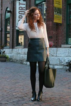 Black leather skirt, opaque black hose, ankle boots