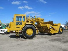 Price: $115,000  2000 CATERPILLAR 621F MOTOR SCRAPER, Showing Low hours, very good condition, just serviced, no leaks, strong engine, transsmission, ready to work Used Construction Equipment, Show Low, Military Equipment, Caterpillar, Engine, Monster Trucks, Plant, Strong, Vehicles