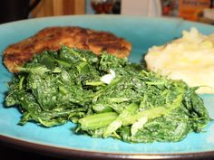 From Best of Gourmet.  These greens can be made ahead and then cooked in the garlic butter for final presentation.