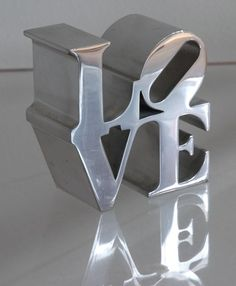 """our wedding theme was """"love"""" -- this is just a placeholder/reminder to try to dig up some of the metal """"love"""" sculptures that we had at the reception... maybe put them on little shelves high up?"""