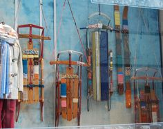 love the old sleds... use them to display scarves, winter hats, gloves, and boots.