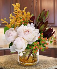 Flowers always make the spirit bright and add easy elegance to any party. This arrangement adds a touch of autumn, as well. #www.mancusos.com #Detroit #Michigan #Flowers #Gifts #Fall #Autumn #Thanksgiving
