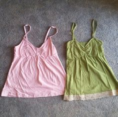 Hollister tanks Bundle - size L One light pink tank with 3 buttons on in the top middle. One olive green tank with lace lined hem. Smoke free home. Make an offer. Hollister Tops Tank Tops