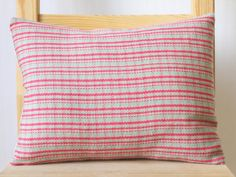 Handwoven on a four shaft loom in my London studio, striped, plaid effect. Has an envelope fasting and comes with a duck feather filled pad. Each cushion is unique, and is an individual piece of hand weaving. Treasure it. This cushion measures 12 x 16 100% merino wool blend front 100% cotton canvas back Please hand wash the cover. Made in London