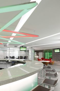 Lipse Chairs (red with veneer backs) in the Heineken NYC Headquarters - designed by TSC Designs (Now Mancini Duffy)