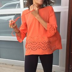 """💋Ya Coral Bell Sleeve Top💋 Pretty flowey top.  Somewhat sheer.              .. Bell sleeves with laser cut out detail on sleeves and hem.. Size large.. Pull over style ..measured flat: Length:24.5"""" Shoulder to shoulder:16"""" Pit to pit:20""""  Sleeve:17.5"""" ..70%Cotton 30%Poly .. Small faint stain on the back shown in picture.. Hard to see .. No trades no pay pal .. Ya Los Angeles Tops Tunics"""