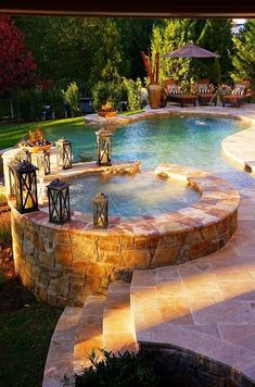 Beautiful Backyard Pool Hot tub decorated with charming lanterns to create a romantic feel. #hottub #jacuzzi #ideas