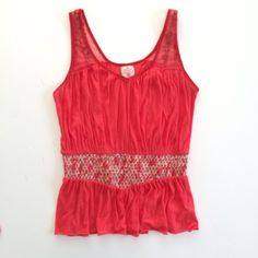 [Free People] smocked-waist top Pimento top in lightweight cotton. Gathered v-neck with red metallic trim. Mesh embroidered tank straps. Smocked waistband and flared hem. Size M. Free People Tops