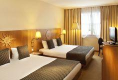 Se trata de una habitación doble para un hotel en Costa Rica. Es muy bonito.