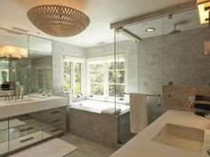 Suzie: Pricey Pads - Modern bathroom with seamless glass shower with marble tiles shower ...
