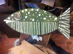 Made from recycled wood. Dark green fish. This fish swam home to New Jersey.