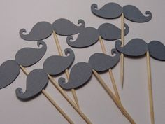 """Grey Mustache Cupcake Toppers - Food Picks - Appetizer Picks - Gray Mustaches - Baby Boy Shower (Set of 24 Toppers). These grey mustache cupcake toppers will be perfect for your party! Size: Mustaches are 2"""" wide. Amount: 24 picks. Colors as shown. They can be used in many foods and deserts, not just cupcakes! Want more variety, be sure to check out Sew Pretty in Vermont for hundreds of options!."""