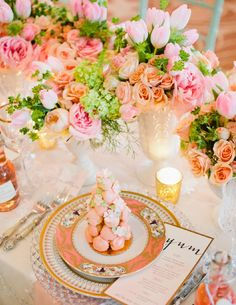 Beautiful summer table with pink and peach roses
