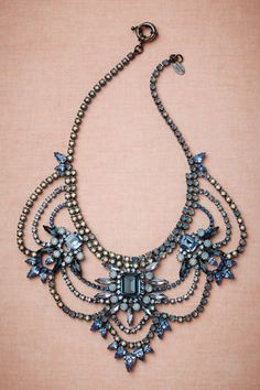 Gorgeous, but too expensive and the metal is a little too dark for a wedding.  Polar Seas Necklace