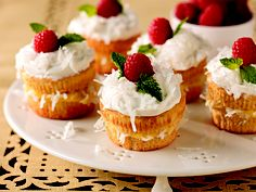 Coconut Cream Cupcakes dessert recipe with COOL WHIP Frosting and Raspberries