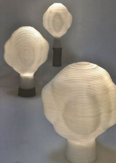 New asteroid-like corrugated polypropylene LED 'Bonsai' table lamps by Japanese designer Sugata Katachi are formed of tiny plastic compartments, which, according to the designer, 'condense an entire landscape onto each lamp and create a new universe around them'.