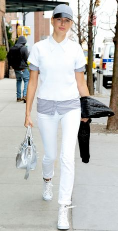All-White Outfit + Baseball Hat = Karolina Kurkova's Look  On Kurkova: Adidas trainers  Get The Look: Joie Ayana Top ($178) in Porcelain; Joe's Slim Fit Jeans ($148) in Cotton; J....