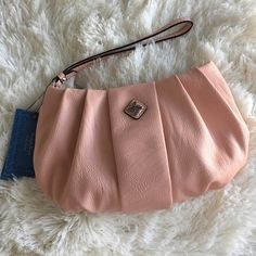 "peach wristlet New with tags. New condition. Has wrist strap (non-detachable). Width at widest point is 10 inches, 6 inches in height. Zipper pocket inside along with 6 credit card slots and a cash slot. iPhone 6s Plus fits inside comfortably with room for other necessities. ❌no trades or Paypal Quick shipping Offers welcome through ""Make an Offer"" feature. Simply Vera Vera Wang Bags Clutches & Wristlets"