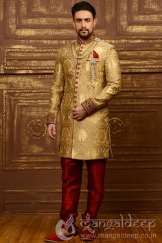 Golden Banarasi Silk Wedding Wear Heavy Embroidery Work Sherwani. For more information :- Call us @+919377222211 (Whatsapp Available)