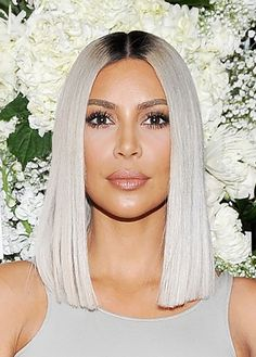 - Kim attended a dinner in LA for The Tot, debuting her newly coiffed lob. Paired with her cool platinum hue the effect is decidedly ice queen and we're into it.
