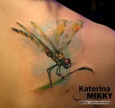 awesome dragonfly tattoo by Katerina Mikky.  Would like similar dragonfly, only smaller, resting on bobber tattoo