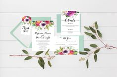 Vibrant watercolor bouquets and your choice of black or gold font featured on a gorgeous wedding invitation suite