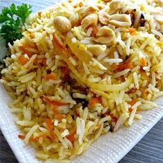 Carrot Rice - fragrant basmati rice sauteed with carrots, onions, fresh ginger, peanuts, and cilantro Rice Recipes, Side Dish Recipes, Indian Food Recipes, Asian Recipes, Vegetarian Recipes, Cooking Recipes, Ethnic Recipes, Vegetarian Dish, Gastronomia