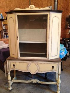 Antique storage cabinet upcycled with Dixie Belle Paint Company's Rebel Yell-ow chalk paint