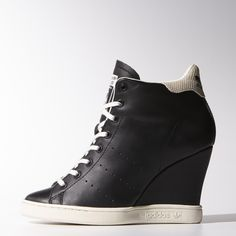 e9013989dc7 The legendary Stan Smith shoe goes upward in these women s shoes. Built  with a wedge