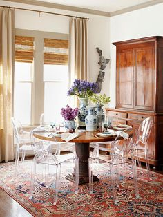 Oriental rug + lucite chairs = perfect balance of old and new, traditional with a twist