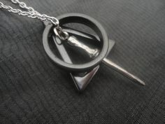 please ->> Deathly Hallows Necklace, $22.80