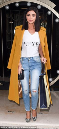 Great jeans: Lucy Mecklenburgh was taking her split in her stride as she stepped out at the star-studded Aspinal show in London on Monday