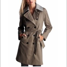 Gorgeous wool-lined classic gap trench coat! This is a mint condition trench from gap. It has a removable grey wool lining and collar so it is perfect for fall or even winter weather! When you remove the wool lining or roll the sleeves you will see a gorgeous golden yellow silky lining. It is in perfect condition. The belt is not pictured but that will come with it as well. It is an xs but it runs quite large, it would fit a small or medium as well. Let me know if you have any questions! GAP…