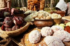 Viking Rus food being prepared. The meat patties in front are large meatballs filled with a boiled egg and chopped onions.