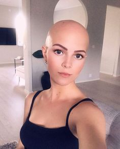 I love a bald woman. It's brave and empowering, where she shaved it to rebel, or lost it due to alopecia or cancer and didn't hide it. Hair does NOT define a woman, nor is it what makes a woman sexy Shaved Head Women, Bald Head Women, Girls With Shaved Heads, Bald Women Fashion, Bald Look, Crop Haircut, Shaved Hair Designs, Bald Hair, Pixie Cut