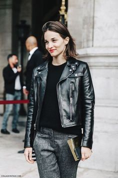 Fall trends | Black leather jacket over black sweater and grey pants