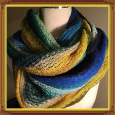 """Long Colorful Knitted Scarf The colors are gorgeous. Great scarf to add style to your winter outfit. Very warm, as well as versatile with wrapping options. It's 88"""" long and 27"""" wide. Awesome scarf! A couple tiny snags but not noticeable. Accessories Scarves & Wraps"""