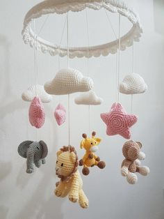 Mobile safari with ruffled frame at Crochet Baby Mobiles, Crochet Mobile, Crochet Baby Toys, Crochet Gifts, Crochet Animals, Baby Knitting, Amigurumi Patterns, Crochet Patterns, Stuffed Toys Patterns