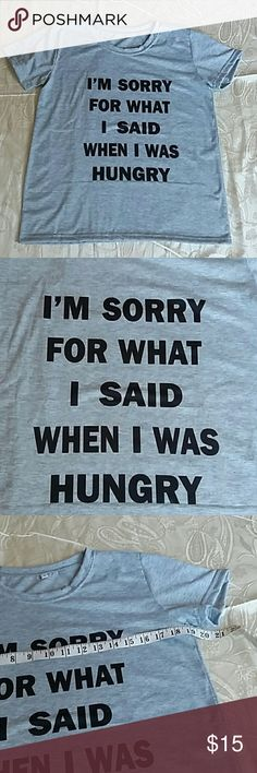 "NWOT gray graphic t-shirt Size large gray graphic t-shirt.  Reads "" I'm sorry for what I did when I was hungry. "" New without tags, never worn. Tops Tees - Short Sleeve"