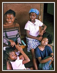 africathebeautiful:    Portrait of four little girls in Liberia that is exactly how I started. Lol