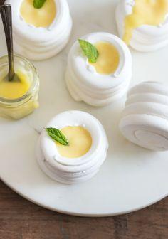 Lemon Curd meringue nests from Pretty.Sweet I via Frankie Mini Desserts, Elegant Desserts, Plated Desserts, Lemon Curd, Pavlova, Fresh Fruit, Grain Free, Macarons, Nest