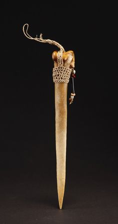 Bone dagger, from the Asmat people of Papua. Created from the thighbone of a cassowary bird.