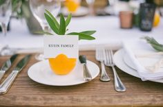 rustic tablescape with a citrus name card